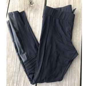Black leggings with pleats and pleather accents
